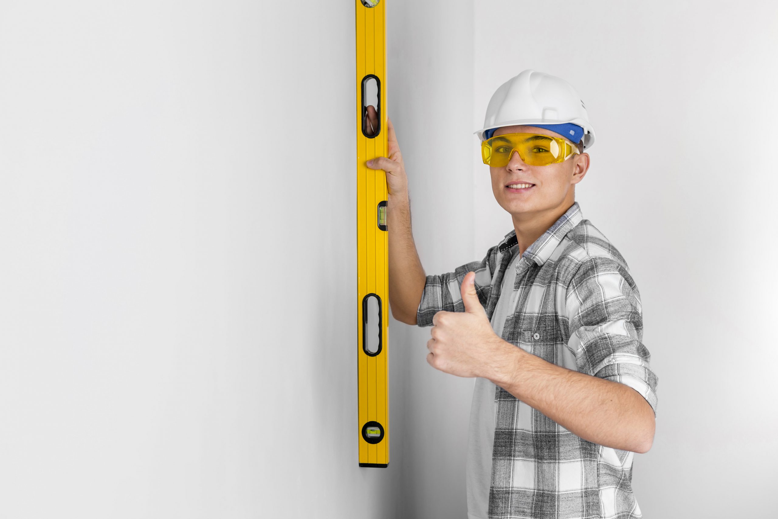 https://fbrconstruction.com/wp-content/uploads/2020/10/worker-with-spirit-level-wall-min-scaled.jpg